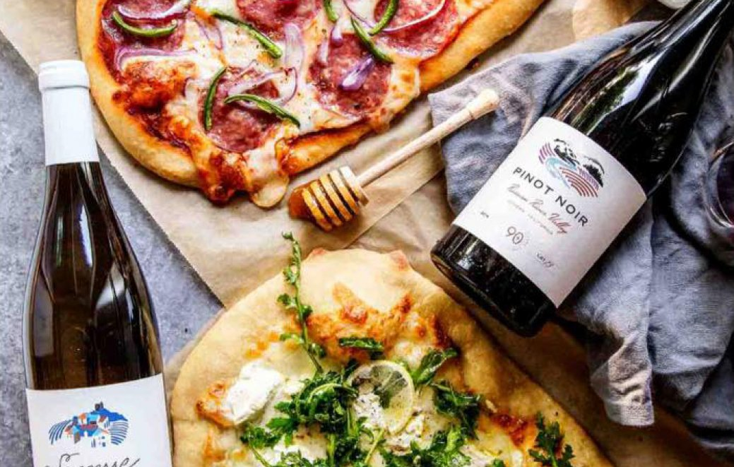 Pizza and bottles of wine